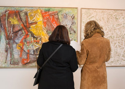 Guests viewing the art